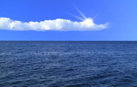 suns: blue sky with white clouds, the suns rays and sea spreadeth Stock Photo