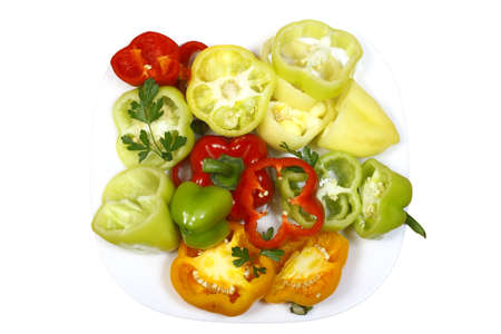sweet pepper chopped multicolored on a plate isolated on a white background Stock Photo - 7759463