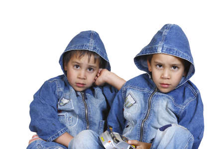 little twin brothers in dzhinsovyhkurtkah isolated on a white background Stock Photo