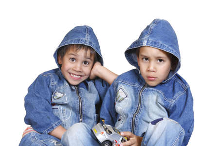 little boys, twins in a denim jacket isolated on a white background