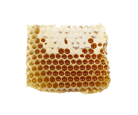 honeycomb filled with honey, isolated on white background Stock Photo