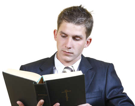 young man in a suit Bible study isolated on a white background Stock Photo