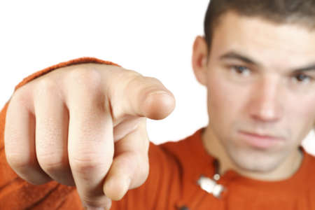 a guy points a finger at the camera isolated on white background photo