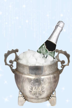 Silver bucket of ice and a bottle of champagne on a blue background