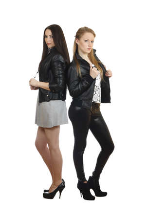 two young girls in full-length isolated on white background