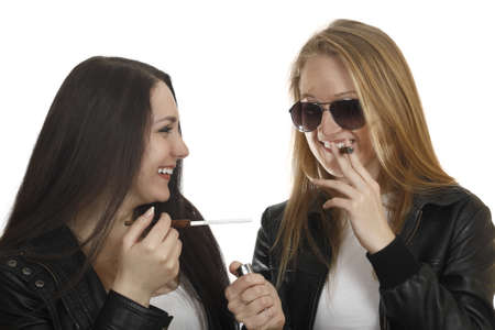 two smoking girls isolated on white background photo