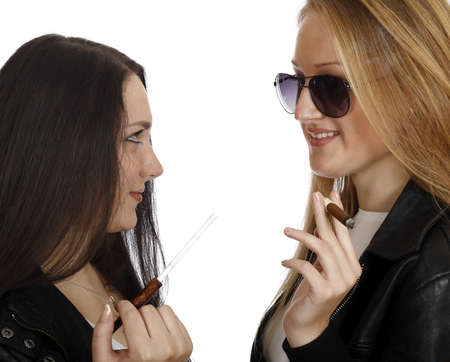 two girls with cigarettes isolated on white background  photo