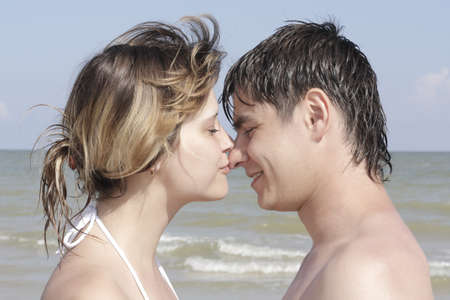 young men kissing in the background of the sea close