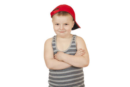 boy stands with his hands folded on his chest isolated on white background  Stock Photo