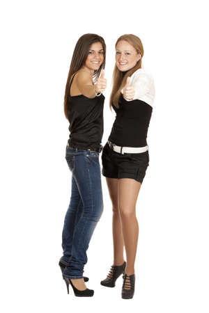 Two girls picked up the thumbs up to his full height isolated on white background