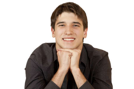 chin on hands: young man sits propped his chin hands isolated on white background