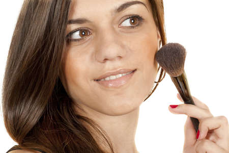 girl doing makeup face isolated on white background  Stock Photo
