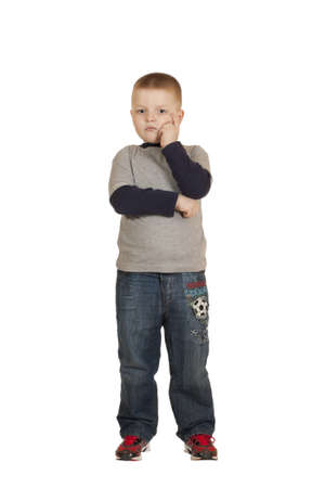 boy stands his head in his hands isolated on white background  Stock Photo