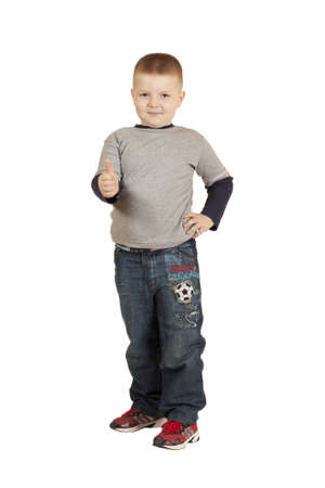 full height: boy to his full height with his hand raised isolated on a white background Stock Photo