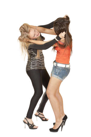 Two girls fight pulling her hair isolated on white background Stock Photo - 9821139