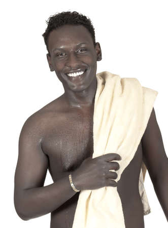bare skinned: The dark-skinned young man with bare torso and a towel isolated on white background Stock Photo