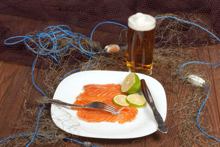 Still Life with sliced pickled salmon photo