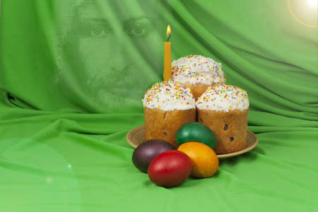Easter cake and colored eggs on a background of green material photo