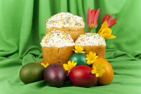 Easter cake and colored eggs on a background of green material Stock Photo - 13395052