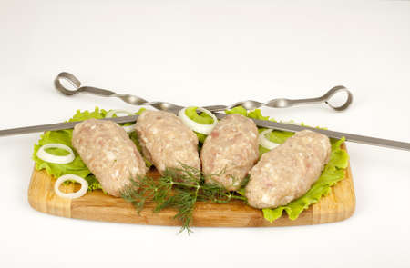 forcemeat: forcemeat chicken molded to kebab skewers with