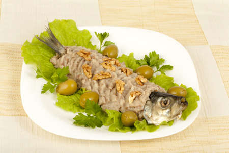 herring, chopped nuts on a plate with a close-up photo