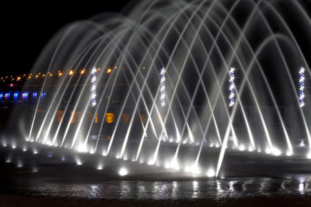 beautiful fountain in  night on the town quay photo