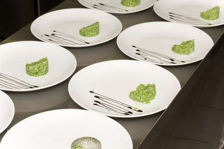 dish in a restaurant kitchen to feed garnish Stock Photo