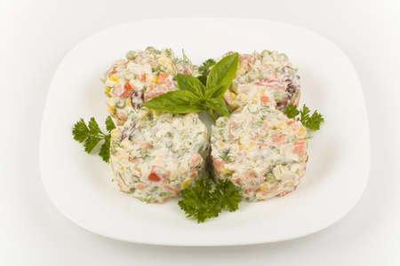 Margot salad with mayonnaise lined with pastry rings photo