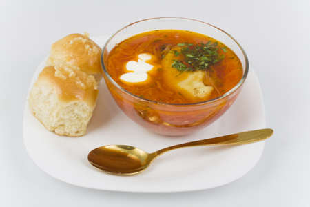 Ukrainian borsch with donuts in a glass bowl photo