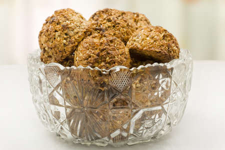 Oatmeal cookies in a crystal vase closeup photo