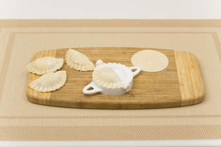 making dumplings with a special device photo