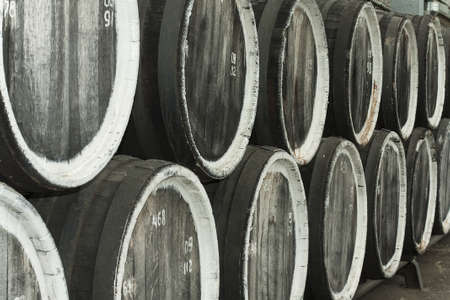 maturation: old wine barrels at the winery closeup Stock Photo