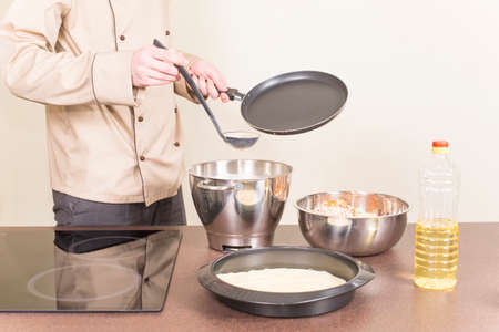 capacitance: cook fry pancakes firm clothes Stock Photo