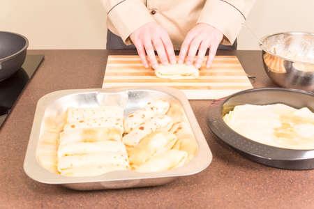 capacitance: cook on the kitchen table prepares empanadas