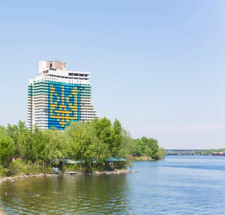 dnieper: the biggest arms of Ukraine on an unfinished building in Dnipropetrovsk