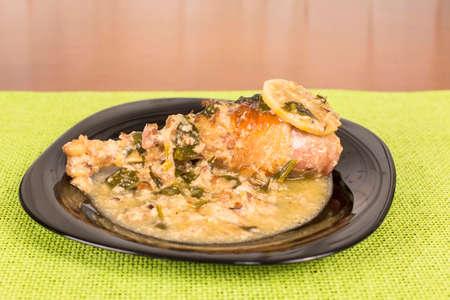 second breakfast: chicken leg braised in mushroom sauce with spinach Stock Photo