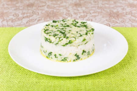 molded: boiled rice with spinach molded using a pastry ring