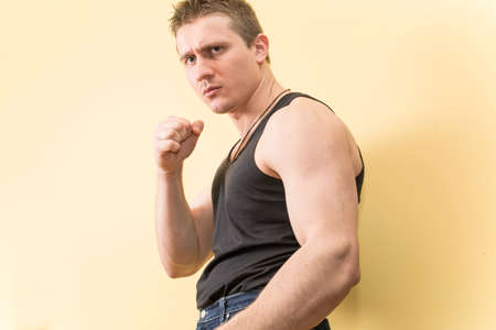 scowl: young man dressed in a Boxing stance Stock Photo