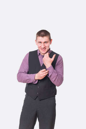 young  cuffs: young man fastening cuffs on the shirt isolated on white background Stock Photo