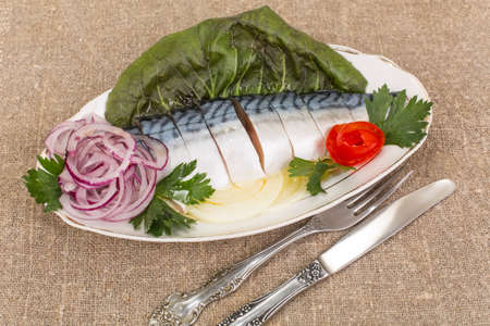 Fillet, salted mackerel sliced and served on celedonia Stock Photo