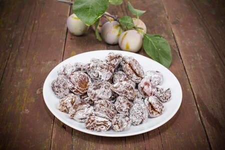 candied: dried plum candied with sugar powder