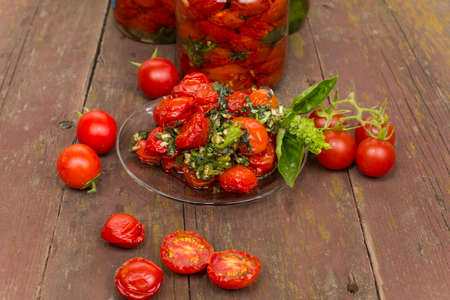 cherry varieties: sun-dried tomatoes cherry varieties on a glass saucer