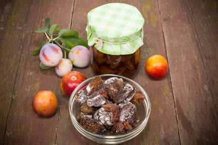 drenched: plum fresh, dried drenched in syrup Stock Photo