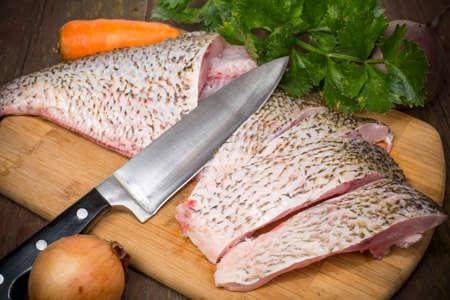 purified: fish bream crude purified on a cutting Board