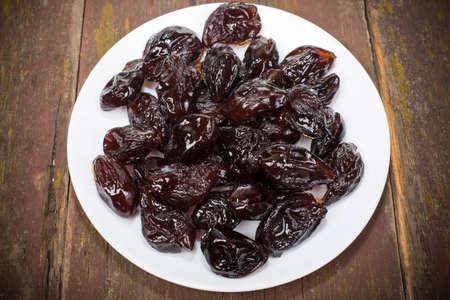 dried plum candied with sugar powder