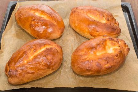 scones: hot homemade scones on the baking sheet