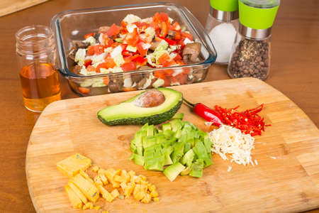 salad vegetables and ingredients sliced on a cutting board Stock Photo