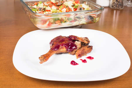 whole leg roasted duck with raspberry sauce and salad