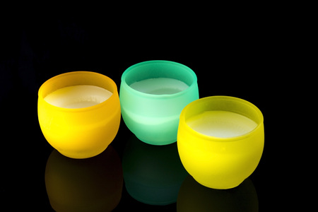 Candles in yellow and turquoise Stock Photo