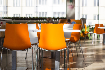 orange dining chairs Stock Photo